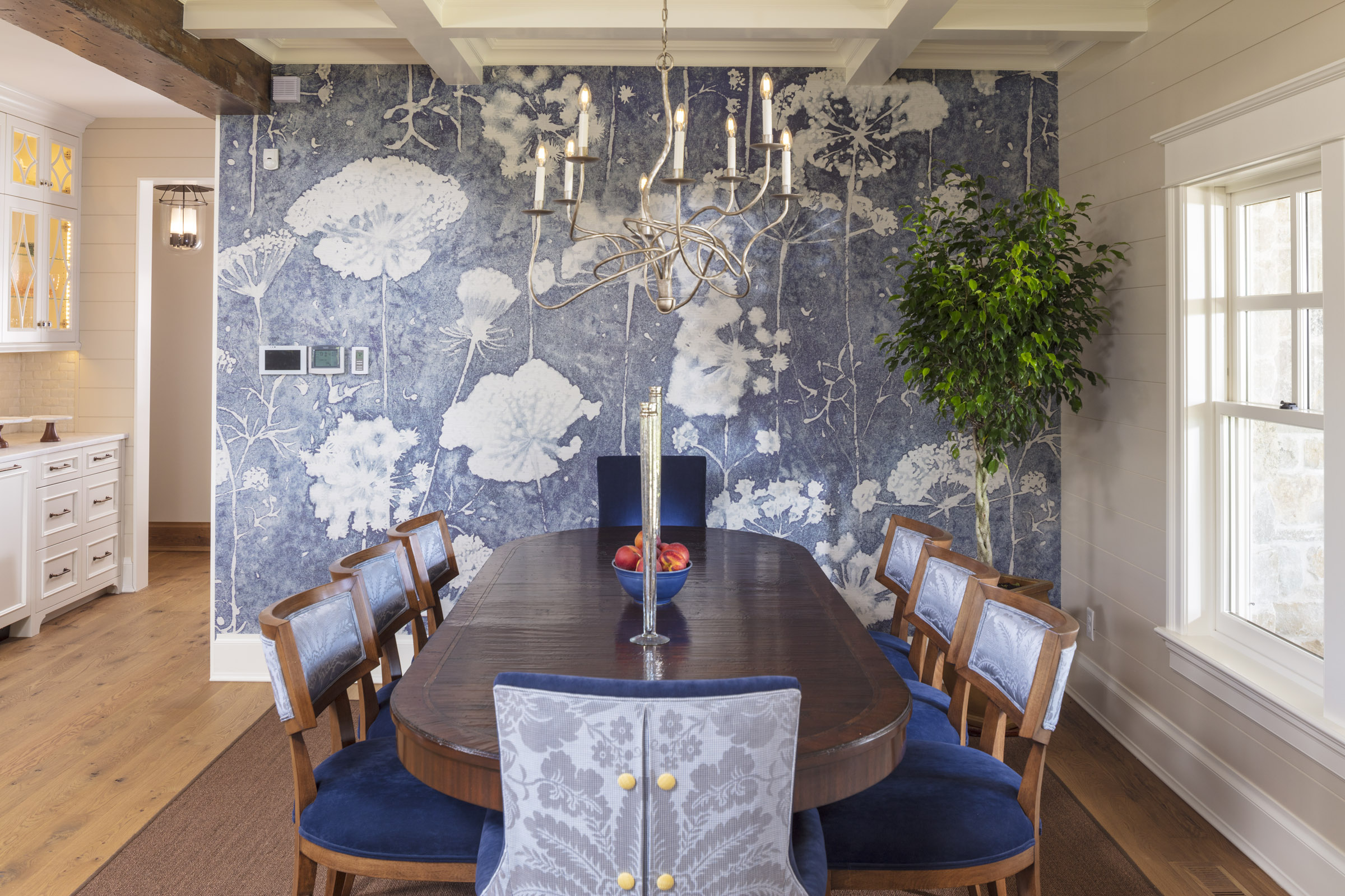 kitchen table with artistic blue flowered wall
