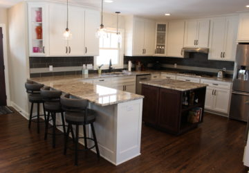 open kitchen white cabinets marble counters